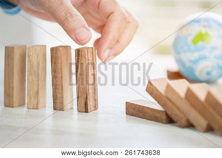 Strategy Planning Risk In Business Concept : Businessman Or Engineer Placing Wooden Block Dominos On