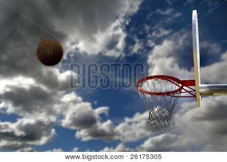 Basketball hoop with blue sky in the background