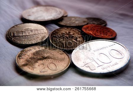 Dark Closeup Of Bunch Of Coins From Various Nationalities Including Singapore 20 & 10 Cents, Copper
