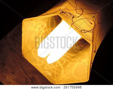 Minimalist Of A Yellow Deep Hexagon Lamp Shade Hanging Diagonally Having Paint Drop Design With Cfl