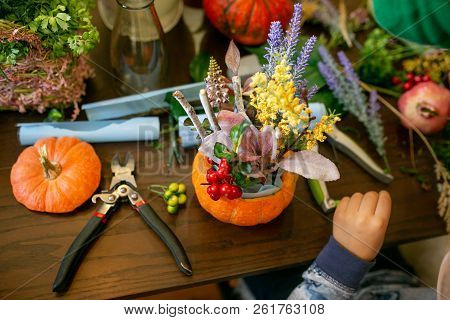 Florist At Work: How To Make A Thanksgiving Centerpiece With Big Pumpkin And Bouquet Of Flowers. Ste