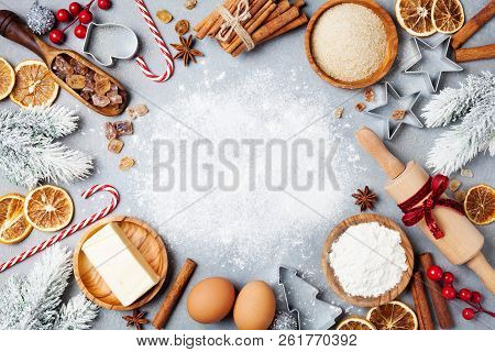 Ingredients For Cooking Christmas Baking Decorated With Fir Tree. Flour, Brown Sugar, Eggs And Spice