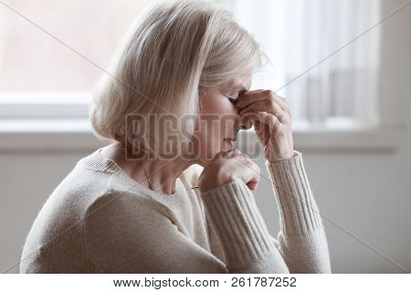 Fatigued Upset Older Woman Massaging Nose Bridge Feeling Eye Str