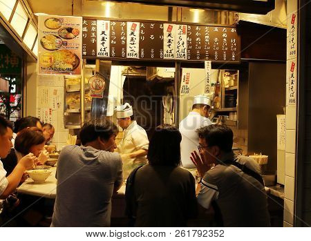 Tokyo, Japan - August, 2nd Of 2017: Local People Mixed With A Few Tourists Dinning In Shinjuku Yakit