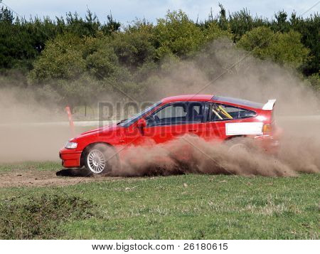 A car competing in a dusty slalom course