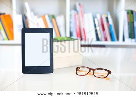 Internet And Electronic Books Concept With E-book Reader