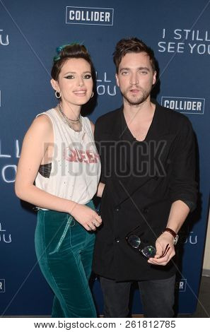 LOS ANGELES - OCT 2:  Richard Harmon, Bella Thorne at the