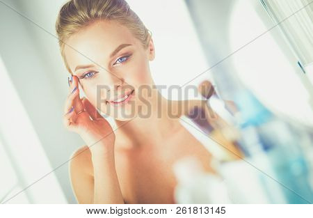 Young Beautiful Woman Making Make-up Near Mirror, Sitting At The Desk
