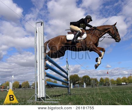 Show jumper against a cloudy sky