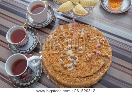 Hazelnut Milk Cake . Delicious Cakes With Hazelnut On Wooden Glass Table . Black Tea In Glass Cup On