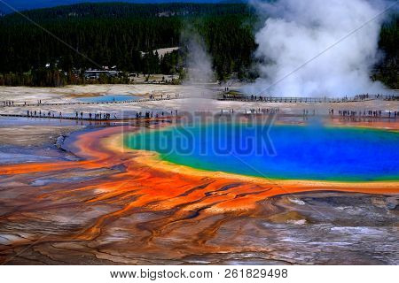 Grand Prismatice Spring in Yellowstone National Park with tourists viewing the spectacular natural scene