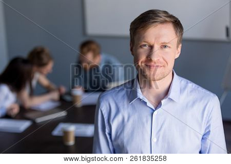 Portrait Of Smiling Successful Company Ceo With Team At Backgrou