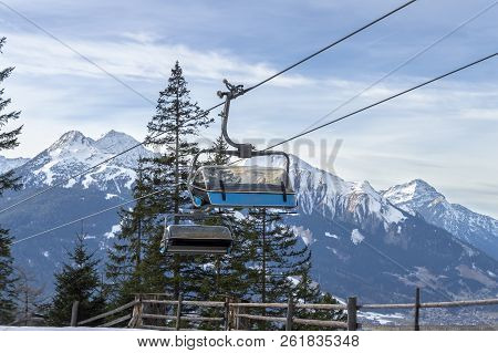 Cable Cars Running Up And Down In The Austrian Alps, Near The Village Ehrwald, With The Snowy Mounta
