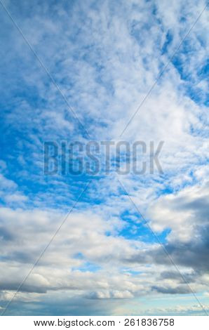 Blue sky landscape scene with white dramatic colorful clouds and evening sunlight.. Sky landscape of blue vast colorful sky clouds. Sunset sky landscape scene with dramatic sky clouds. Blue sky cloudy landscape