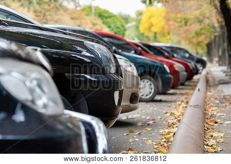 Cars In A Row On Parking Close Up