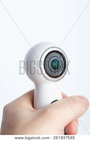 Modern 360 Camera In Hand Close-up View Isolated On White Background