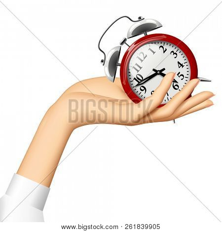 Female hand holding on the palm a red retro alarm clock