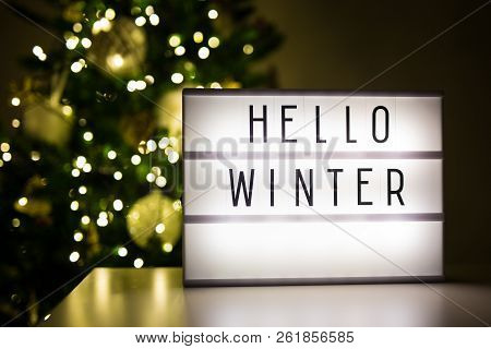 Winter And Christmas Concept - Lihtbox With Text Hello Winter In Dark Room With Decorated Christmas