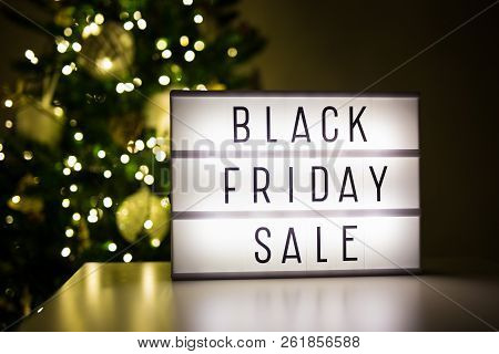 Winter Shopping And Sale Concept - Lihtbox With Text Black Friday Sale In Dark Room With Decorated C