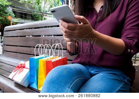 Woman Using Smartphone For Shopping Online In Shopping Mall.