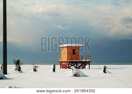 Orrange Lifeguard Tower At The Snow Covered Beach