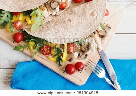 Healthy Whole Wheat Wrap With Chicken, Mushroom, Red Cherry Tomatoes, Yellow Capsicum, Arugula Leave