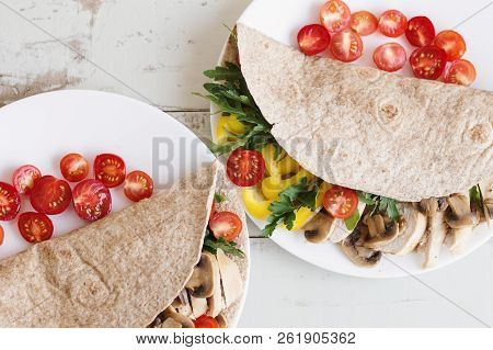 Two Portions Of Healthy Sandwiches With Whole Wheat Wrap, Chicken Breast, Mushroom, Cherry Tomatoes,