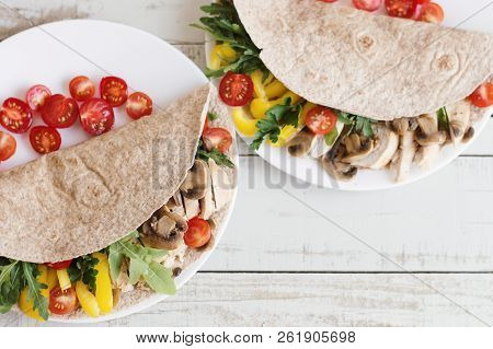 Whole Wheat Burrito Wraps With Chicken, Mushrooms, Cherry Tomatoes, Pepper, Arugula And Parsley. Hea