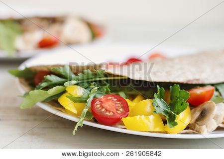 Wrap With Chicken, Mushroom, Red Cherry Tomato, Yellow Capsicum, Parsley And Arugula. Balanced Meal