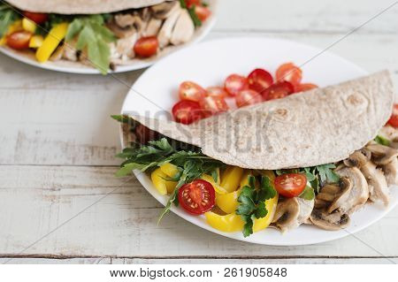 Sandwich With Whole Wheat Wrap, Chicken Breast, Mushrooms And Seasonal Vegetables And Herbs. Balance