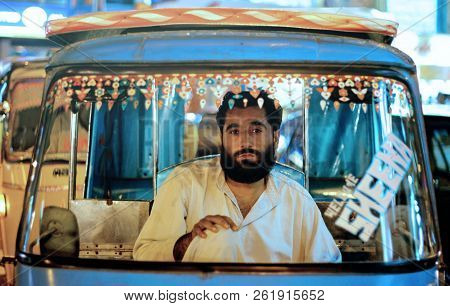 Riksha Driver Sitting And Waiting For Passengers At Bahadurabad, Karachi Pakistan 13/03/2013