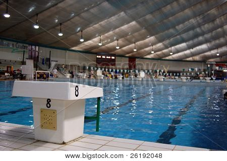 swim race starting block and indoor pool; Calgary, Alberta