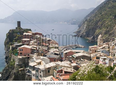 small Italian village clinging to the hillside in Cinque Terre, Italy