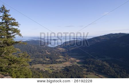 hilltop view of islands and farmland on Saltspring Island, Canada