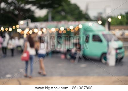 Abstract Blurred Image Of People Walking At The Food Truck Market