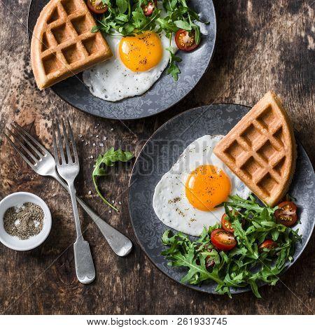 Whole Wheat Savory Waffles, Fried Eggs And Arugula, Cherry Tomato Salad - Healthy Breakfast On Woode