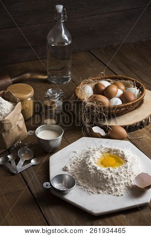 Bakery Ingredients : Flour, Eggs, Butter, Sugar And Rolling Pin On Vintage Wood Table, Sweet Baking