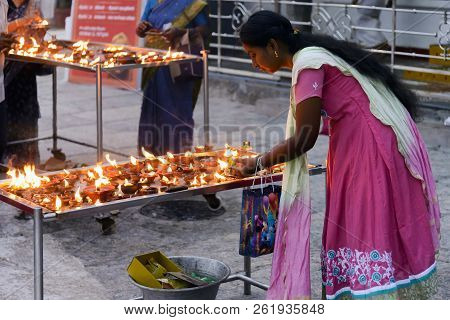 Chennai, India - August 18, 2018: A Woman Light A Candle In Front Of Lord Shani Shrine In Kapaleeshw