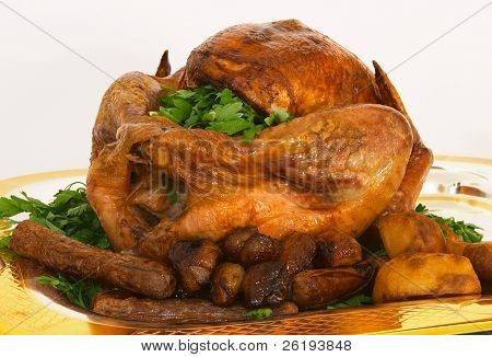 Roast turkey, front view, with trimmings on a silver and gilt tray.