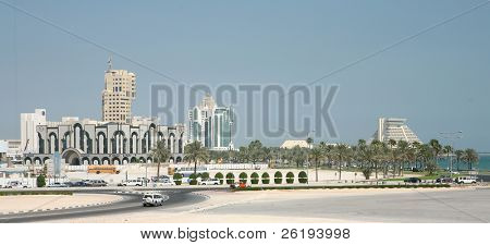 Skyline of Doha, Qatar, New District in October 2005. Doha is being rebuilt at breakneck speed. Please note that this image contains many trademarks or copyrighted logos. It is only for editorial use.