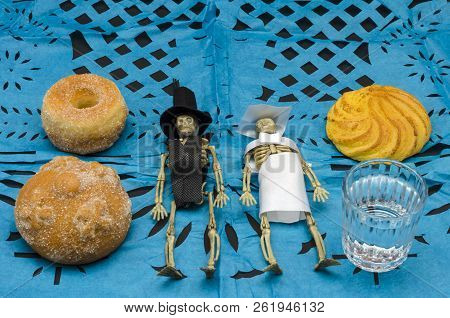 Plastic Skeletons Dressed As Bride And Groom In An Offering Altar For Mexican Day Of The Dead With B