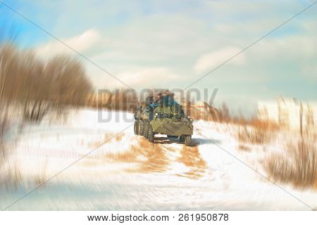 Blurred Image Of Spectators Riding On An Armored Personnel Carrier During The Festival Of Reenactors