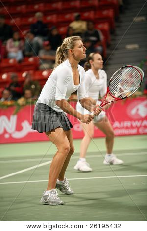 Maria Kirilenko (foreground) and Martina Hingis in the semi-final of the Qatar Total Open doubles, in Doha, March 2, 2007