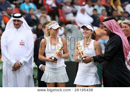 Martina Hingis (centre right) and Maria Kirilenko recieve the doubles champions' trophy at the Qatar Total Open, Doha, March 3, 2007