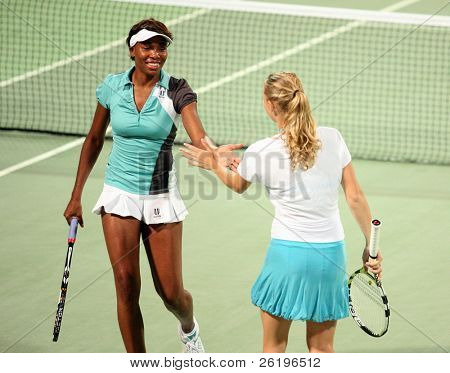 Doubles partners Venus Williams from the US and Caroline Wozniacki of Denmark at Qatar Total Open, February, 2008