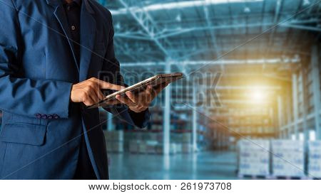 Logistic And Transport Concept : Businessman Manager Using Tablet Check And Control And Planning For