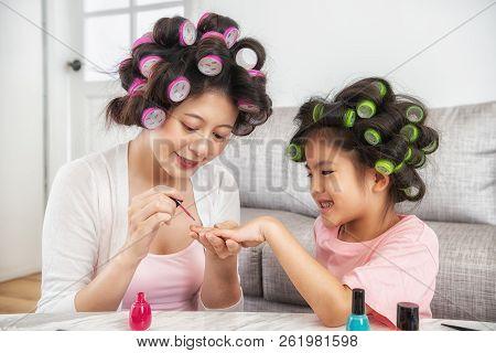 Mom Using Pink Nail Polish Paint Daughter's Nail