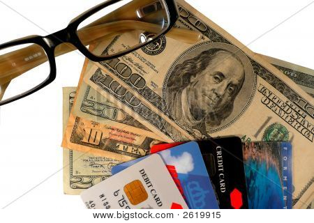 Credit cards and money with a pair of glasses. poster