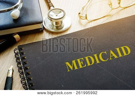 Medicaid Concept. Documents, Pen And The Stethoscope.