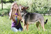 teen girl with dog outdoors poster